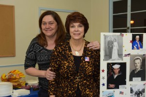 RW&B Dance organizer Sheila Lee R with Jenny Knisley on the L showing veterans photos SP8_0296